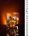 glass of whiskey on black table with reflection, warm tint atmosphere 18421532