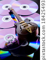 Guitar and CD, bright colorful vivid theme 18425493