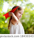 Adorable little girl holding a paper plane 18430343