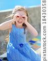 A girl pretending to be looking through binoculars 18430358