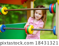 A girl having fun at a playground 18431321