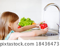 Adorable little girl washing vegetables 18436473