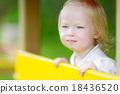 Toddler girl having fun at a playground 18436520
