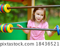 Little girl having fun at a playground 18436521