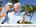 Happy Senior Man & Woman Couple Playing Golf 18443759