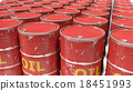 large number of dirty worn scratched oil barrels 18451993