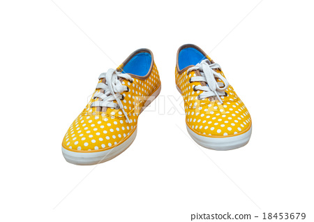 Pair sneakers, vintage dot yellow color on white  18453679