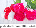 present and red rose 18455444