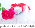 present and red rose 18455446