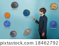 Teen boy businessman in a suit specifies hand on 18462792