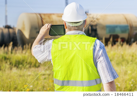 Railway Engineer with tablet PC filmed freight wag 18466411