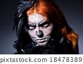 Scary monster in dark room 18478389