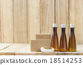 Tubes of bathroom amenity contains on wood 18514253