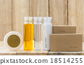 Tubes of bathroom amenity contains on wood 18514255