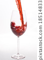 Red wine pouring 18514833