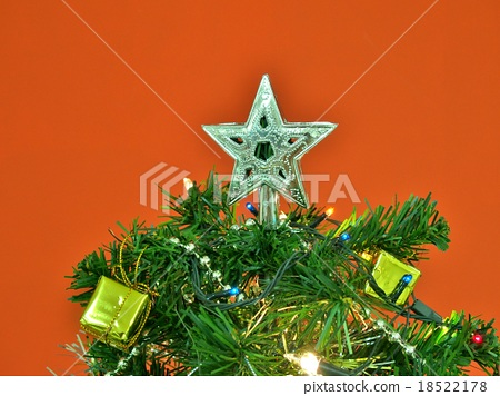 Silver star decorated on the top of Christmas tree 18522178