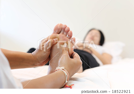 Stock Photo: Woman receiving a foot massage