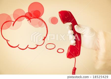 Santa Claus holding retro phone 18525429