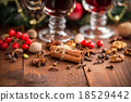 Christmas hot mulled wine with spices on a wooden 18529442