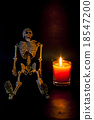 Human skeleton on candlelight Halloween night. 18547200