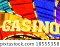 Neon casino sign lit up at night 18555358