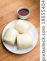 Steamed chinese bun and a cup of tea 18555404