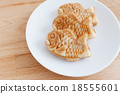 Japanese confectionery taiyaki fish cake wagashi on plate on tab 18555601