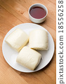 Chinese steamed bun with a glass of tea 18556258