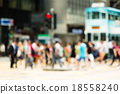 Blurred view of the people crossing the road 18558240