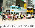 Blurred view of the pedestrian crossing the road 18559101