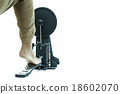 Man playing a base drum pedal isolated 18602070