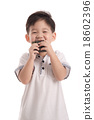 Cute asian child eating rice ball or onigiri 18602396