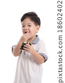 Cute asian child eating rice ball or onigiri 18602402