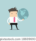 Businessman holds Earth in a hand 18609693