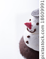 Close up of snowman cupcake on white background 18609991