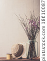 Dry flowers in a vase and vintage hat 18610087