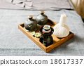 Massage amenities kit in wooden tray 18617337