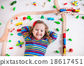 Little girl playing with wooden trains 18617451