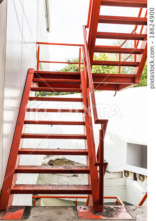 Red Iron Stairs Outside Of Building
