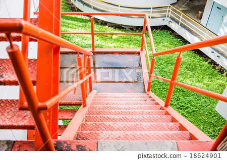 Red Iron Stairs outside of Building 18624901