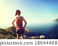 young fitness woman trail runner enjoy the view  18644468