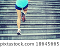sports woman legs running up on stone stairs 18645665