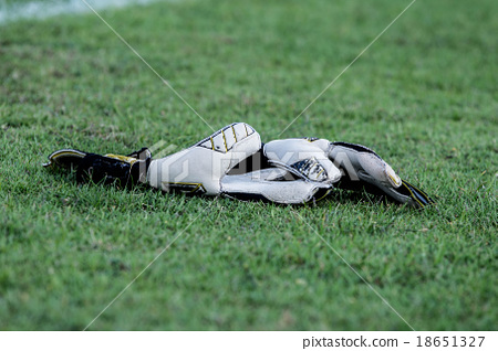 goalkeeper gloves in the grass on  football field 18651327
