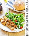 Grilled chicken skewer with salad 18652431