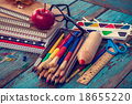 Office or school supplies on wooden planks 18655220