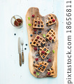 Soft Belgian waffles with berries, honey and mint 18656811