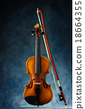 violin with bow on blue background. 18664355