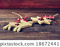 wooden christmas ornaments on a wooden surface 18672441