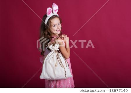 Child girl is wearing rabbit ears, christmas time 18677140