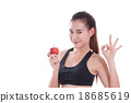 woman holding apple and showing ok sign 18685619